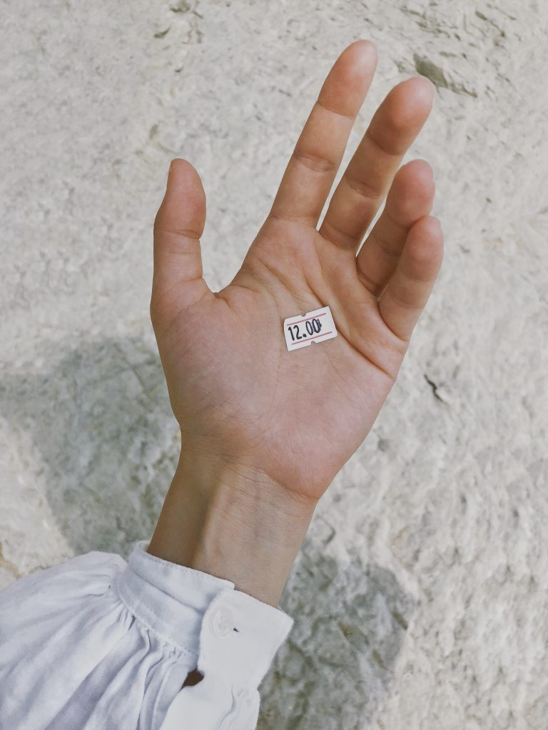 hand with a price tag